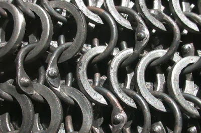 Alternating punched (flat, sheet metal) and riveted (round, wire) rings.
